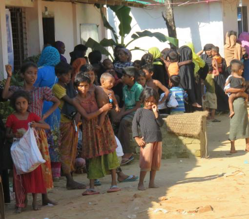 Rohingya children wait outside of an IOM medical clinic; photo taken by Dr. Zarni at the Kutupalong refugee camp in Bangladesh