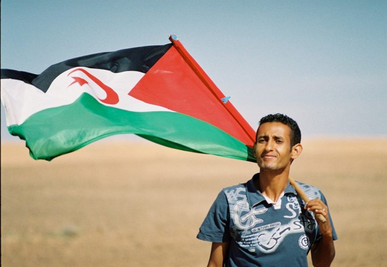 Sahrawi With Flag; accessed via Wikimedia Commons
